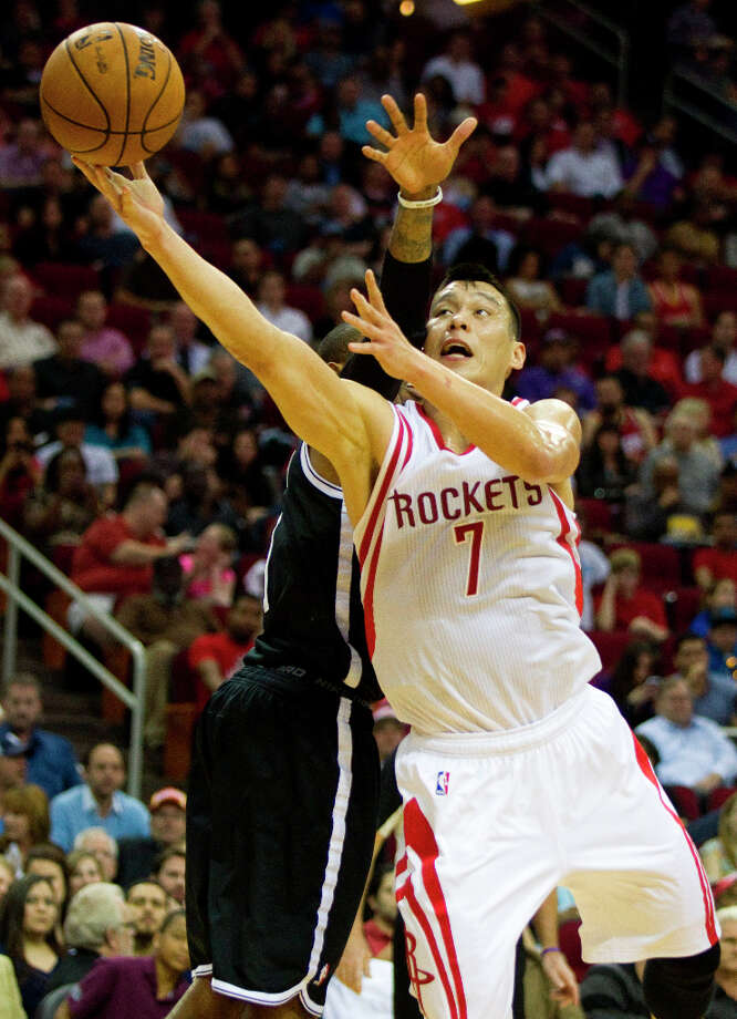 Rockets point guard Jeremy Lin (7) drives in for a shot past Nets point guard C.J. Watson. Photo: Brett Coomer, Chronicle / © 2013 Houston Chronicle