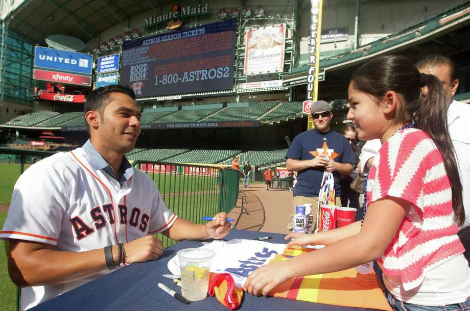 Fans hope Carlos Pena, left, can be a much-needed run producer in the middle of the Astros' order as their first-ever regular designated hitter. Photo: J. Patric Schneider, Freelance / © 2013 Houston Chronicle