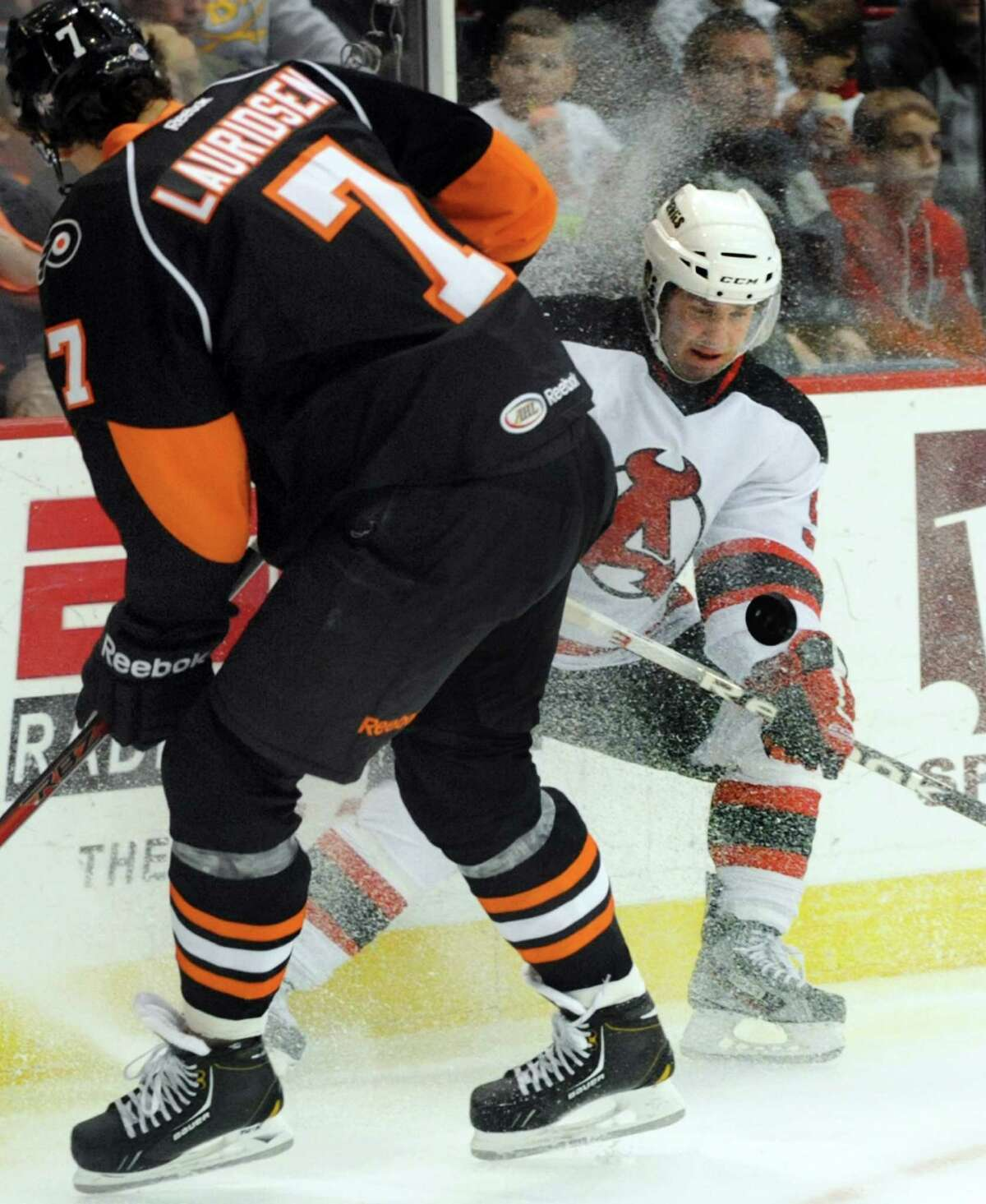 Devils' Joe Whitney (9), right, battles for a loose puck with Phantoms' Oliver Lauridsen (7) during their hockey game on Saturday, Jan. 26, 2013, at Times Union Center in Albany, N.Y. (Cindy Schultz / Times Union)