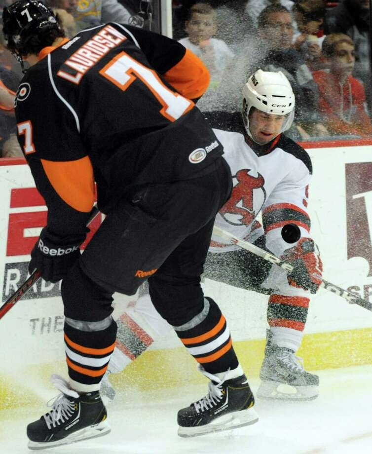 Devils' Joe Whitney (9), right, battles for a loose puck with Phantoms' Oliver Lauridsen (7) during their hockey game on Saturday, Jan. 26, 2013, at Times Union Center in Albany, N.Y. (Cindy Schultz / Times Union) Photo: Cindy Schultz / 00020855B