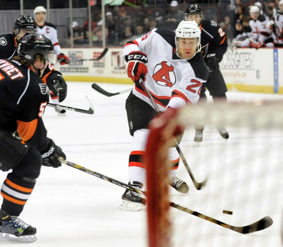 Devils' Mike Hoeffel (26), center, shoots on net during their hockey game against the Adirondack Phantoms on Saturday, Jan. 26, 2013, at Times Union Center in Albany, N.Y. (Cindy Schultz / Times Union)