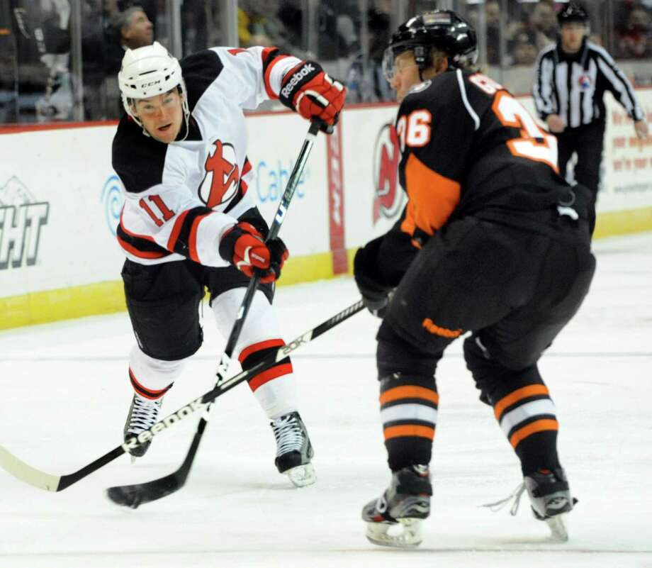 Devils' Bobby Butler (11), left, shoots for the net as Phantoms' Erik Gustafsson (36) defends during their hockey game on Saturday, Jan. 26, 2013, at Times Union Center in Albany, N.Y. (Cindy Schultz / Times Union) Photo: Cindy Schultz / 00020855B
