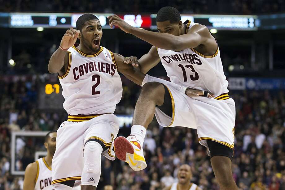 Cleveland's Kyrie Irving (2) celebrates with Tristan Thompson after his game-winning shot to beat the Raptors in Toronto. Photo: Chris Young, Associated Press