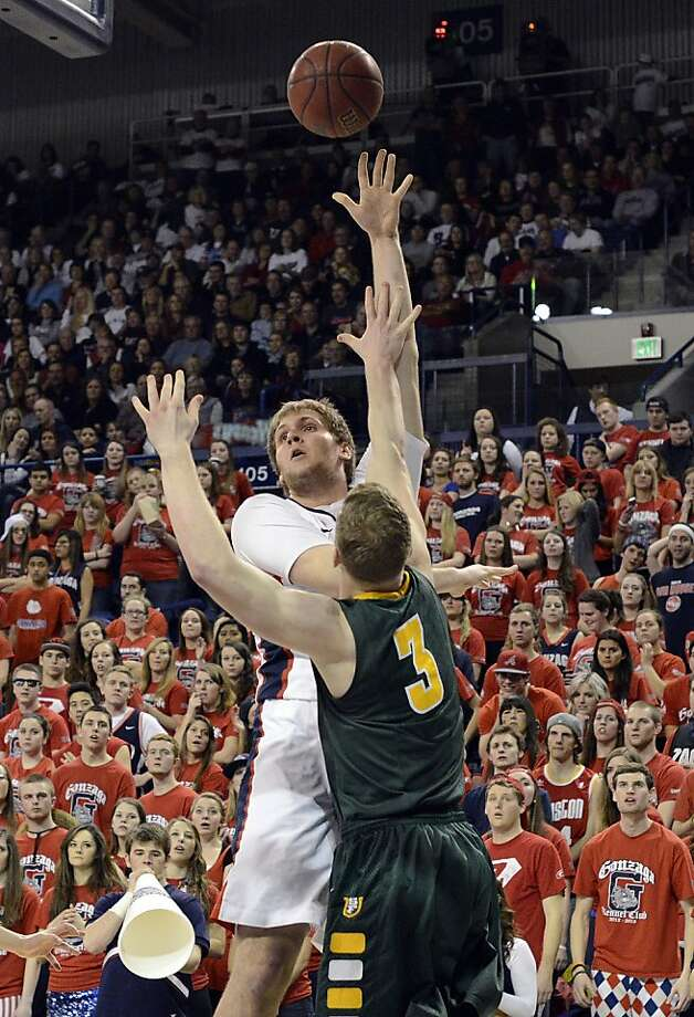 Gonzaga's Przemek Karnowski shoots over San Francisco's Matt Christiansen (3) during the second half of an NCAA college basketball game, Saturday, Jan. 26, 2013, in Spokane, Wash. Gonzaga beat San Francisco 66-52. (AP Photo/Jed Conklin) Photo: Jed Conklin, Associated Press