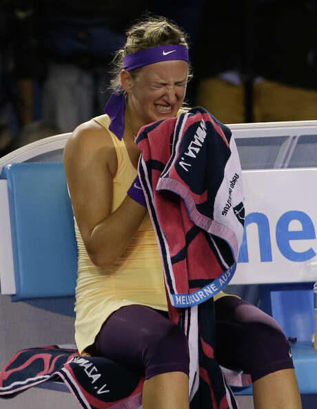 Victoria Azarenka shed tears of joy and relief after knocking off Li Na to claim the title. Photo: Aaron Favila, STF / AP