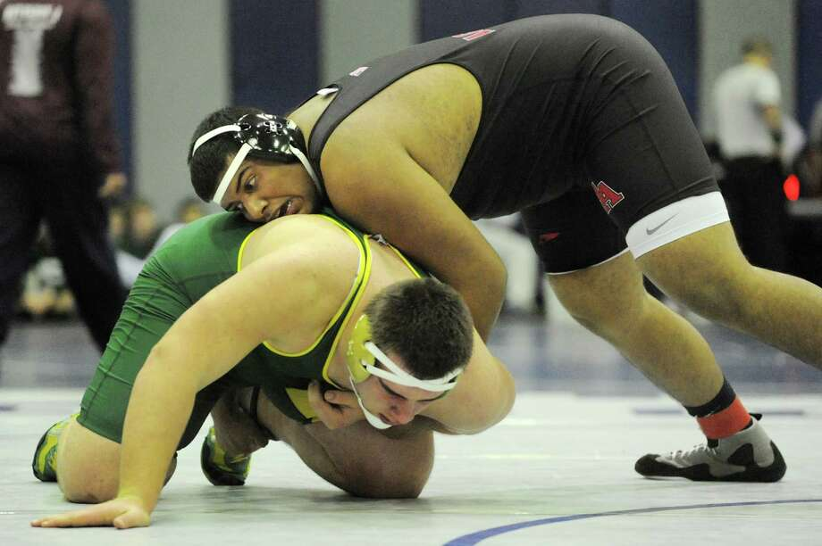 Albany Academy's AHil Dawoodani, top, grapples Northern Adirondack's Scott Guerin at 285 pounds during the Big 10 Wrestling Invitational on Saturday, Jan. 26, 2013, at Albany High in Albany, N.Y. Guerin wins with a pin. (Cindy Schultz / Times Union) Photo: Cindy Schultz / 00020906A