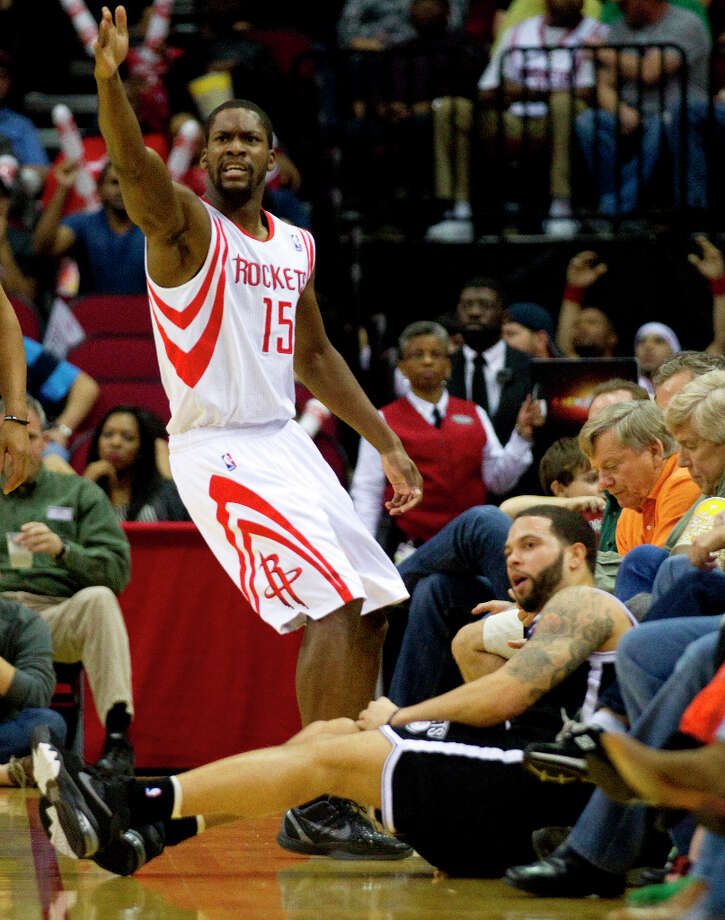 Rockets point guard Toney Douglas (15) looks for a call after he was tangled up with Nets point guard Deron Williams. Photo: Brett Coomer, Chronicle / © 2013 Houston Chronicle