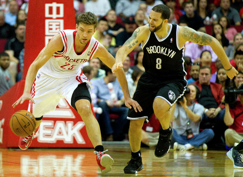 Rockets small forward Chandler Parsons (25) runs upcourt after a turnover by Nets point guard Deron