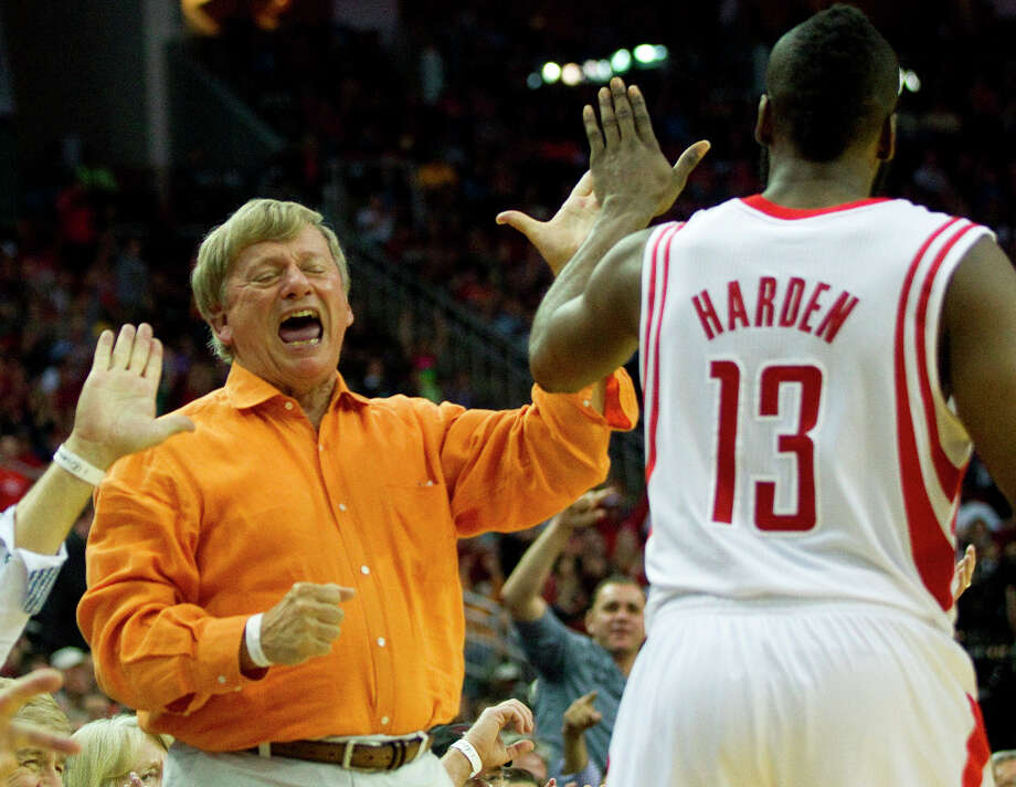 Attorney Rusty Hardin, left, high fives Rockets guard James Harden (13) after Harden scored a basket and was fouled. Photo: Brett Coomer, Chronicle / © 2013 Houston Chronicle