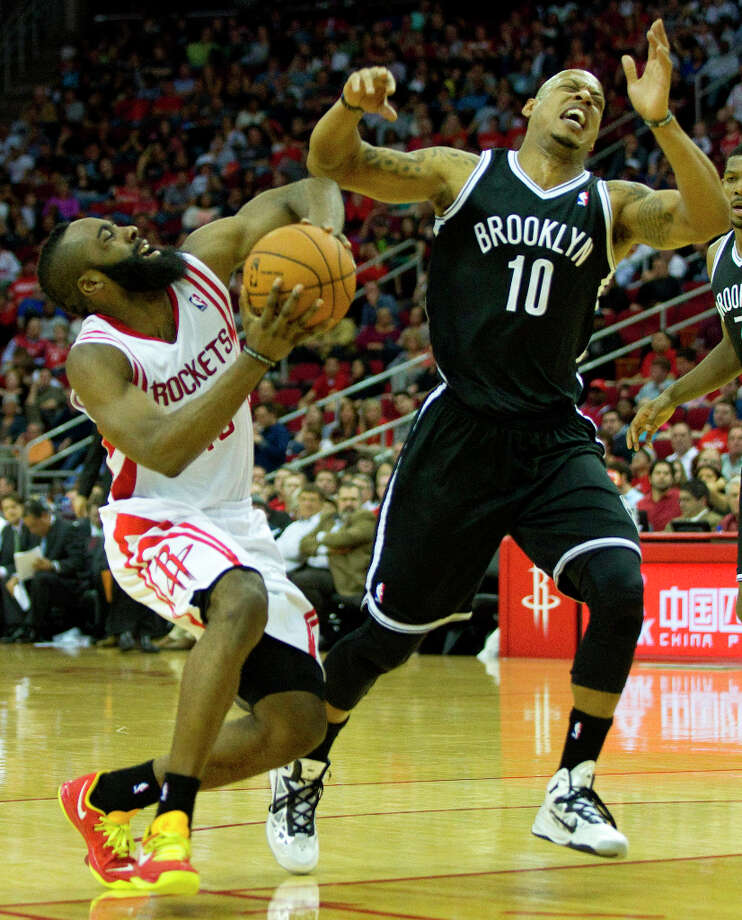 Rockets guard James Harden (13) collides with Nets small forward Keith Bogans. Photo: Brett Coomer, Chronicle / © 2013 Houston Chronicle