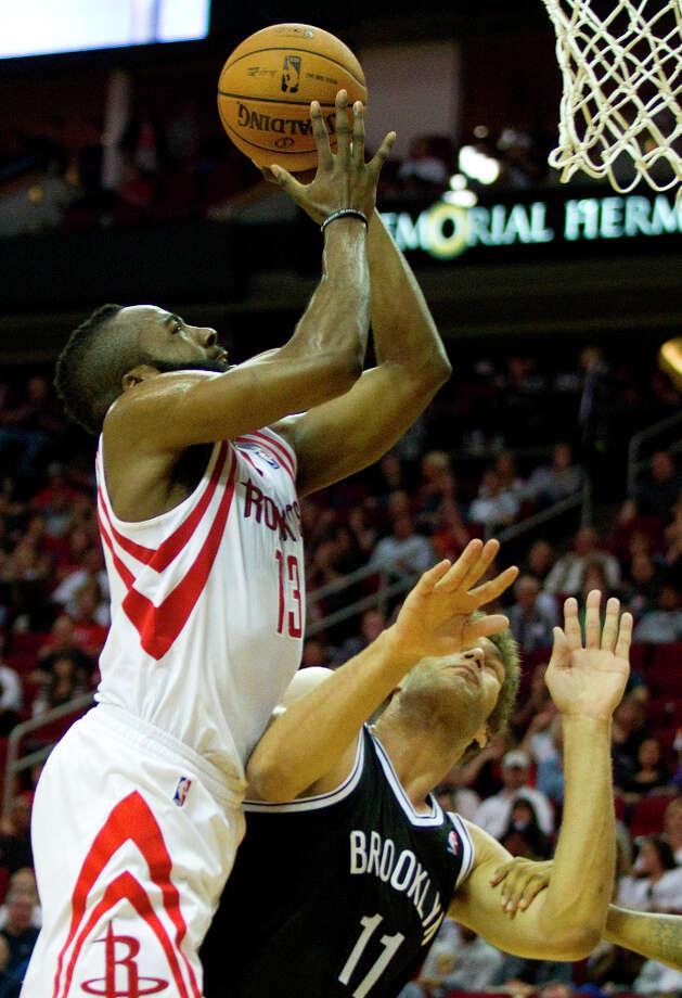 Rockets guard James Harden (13) shoots a basket over Nets center Brook Lopez. Photo: Brett Coomer, Chronicle / © 2013 Houston Chronicle