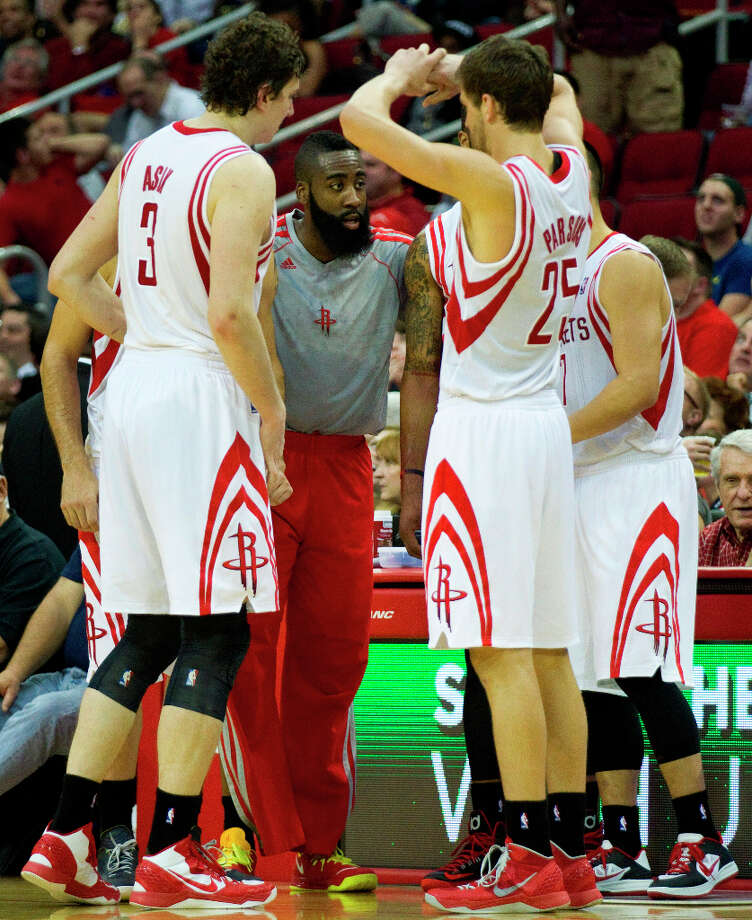 Rockets guard James Harden, center, gathers his teammates, Omer Asik (3), Chandler Parsons (25) and Jeremy Lin (7) as they come out of a time out. Photo: Brett Coomer, Chronicle / © 2013 Houston Chronicle