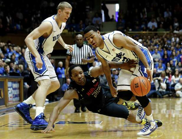Duke's Mason Plumlee, left, and Quinn Cook, right, struggle with Maryland's Dez Wells during the second half of an NCAA college basketball game in Durham, N.C., Saturday, Jan. 26, 2013. Duke won 84-64. (AP Photo/Gerry Broome) Photo: Gerry Broome