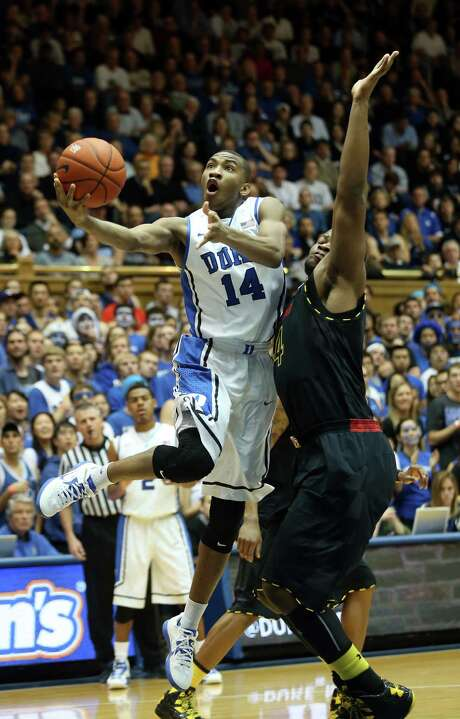 Rasheed Sulaimon, left, had a career game Saturday to help lead Duke to a bounce-back victory. Photo: Streeter Lecka, Staff / 2013 Getty Images