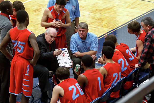 Antonian coach Charlie Boggess talks to his team during a second half time out in their game with Central Catholic at Paul Taylor Field House on Jan. 26, 2013.  Central Catholic beat the Apaches 64-53.  MARVIN PFEIFFER/ mpfeiffer@express-news.net Photo: MARVIN PFEIFFER, Express-News / Express-News 2013