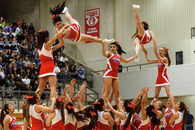 The Antonian Apache cheerleaders perform during halftime of their game with Central Catholic at Paul Taylor Field House on Jan. 26, 2013.  MARVIN PFEIFFER/ mpfeiffer@express-news.net Photo: MARVIN PFEIFFER, Express-News / Express-News 2013