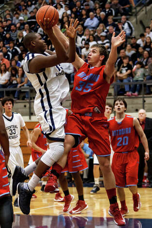 Central Catholic's Tony Lewis (left) puts up a shot over Antonian's Reagan Keogh during the first half of their game at Paul Taylor Field House on Jan. 26, 2013.  Central Catholic beat the Apaches 64-53.  MARVIN PFEIFFER/ mpfeiffer@express-news.net Photo: MARVIN PFEIFFER, Express-News / Express-News 2013