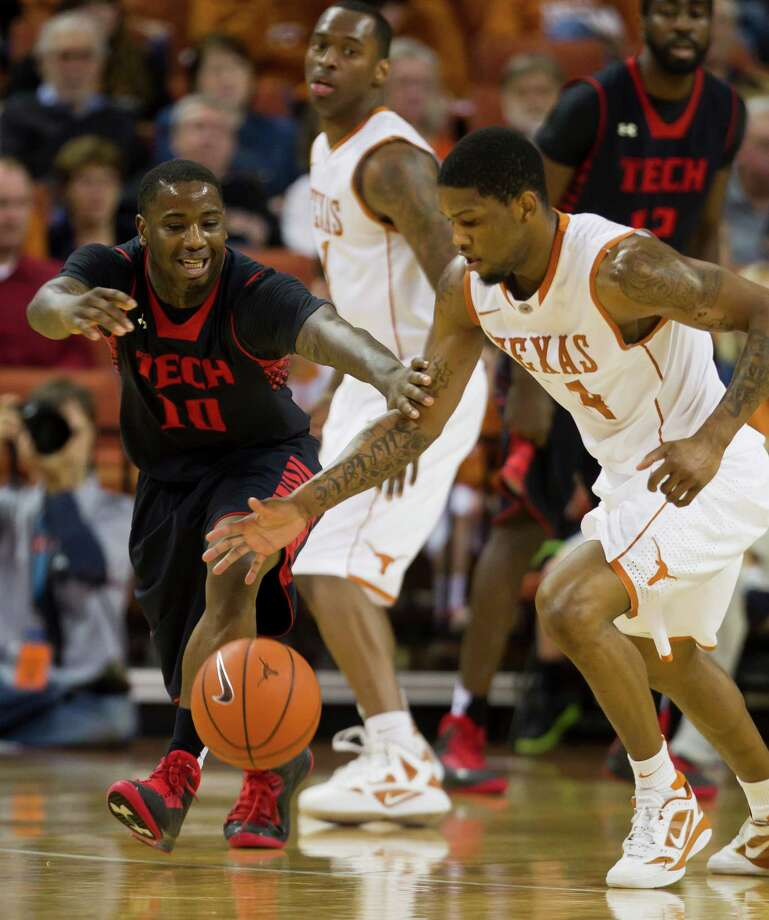 UT's Julien Lewis, right, steals the ball from Texas Tech's Daylen Robinson as the Longhorns ran away from the Red Raiders, 73-57, on Saturday in Austin. Photo: Ricardo Brazziell, Photojournalist / AUSTIN AMERICAN-STATESMAN