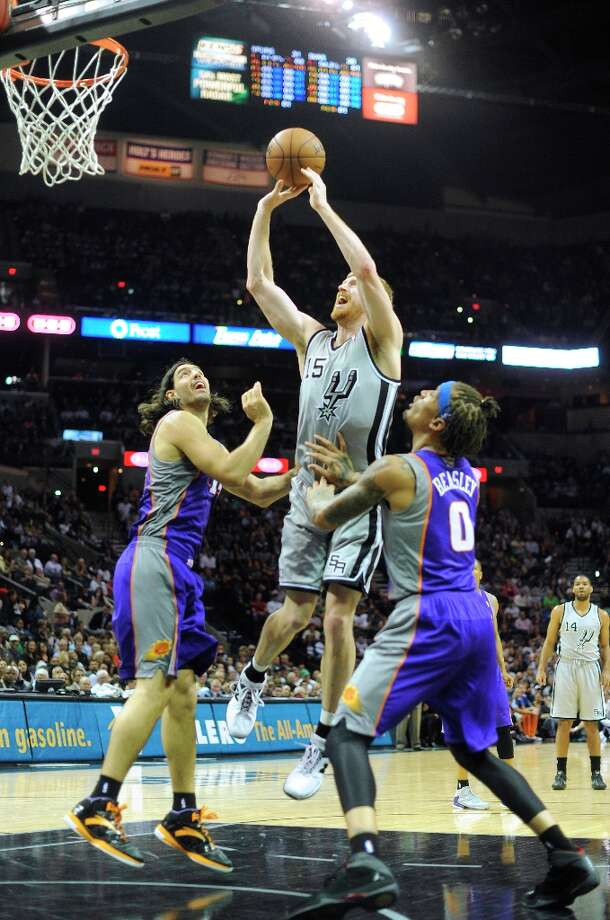 Matt Bonner of the Spurs shoots over Luis Scola (left) and Michael Beasley of the Phoenix Suns at the AT&T Center on Saturday, Jan. 26, 2013. Photo: Billy Calzada, San Antonio Express-News / SAN ANTONIO EXPRESS-NEWS