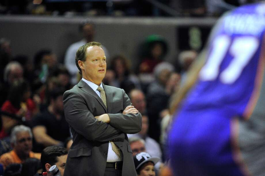 Spurs acting head coach Mike Budenholzer watches the action against the Phoenix Suns at the AT&T Center on Saturday, Jan. 26, 2013. Photo: Billy Calzada, San Antonio Express-News / SAN ANTONIO EXPRESS-NEWS