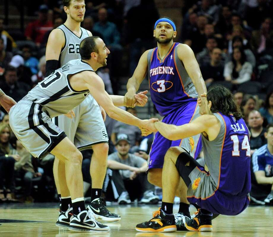 Manu Ginobili of the Spurs (left) and Jared Dudley (3) and Luis Scola (14) of the Phoenix Suns help each other up after a scramble on the floor at the AT&T Center on Saturday, Jan. 26, 2013. Photo: Billy Calzada, San Antonio Express-News / SAN ANTONIO EXPRESS-NEWS
