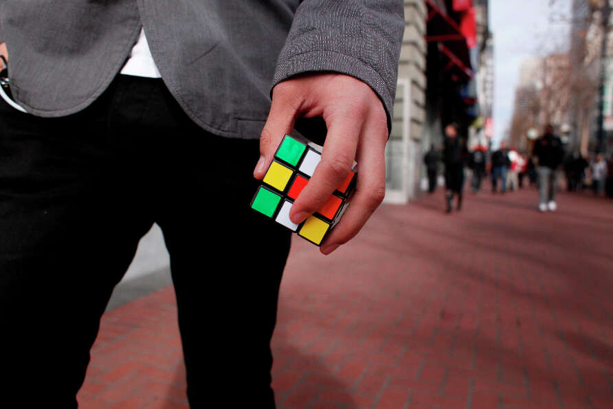 Rubik's Cube at the ready, Francisco Perez, 18, walks down Market Street in San Francisco.