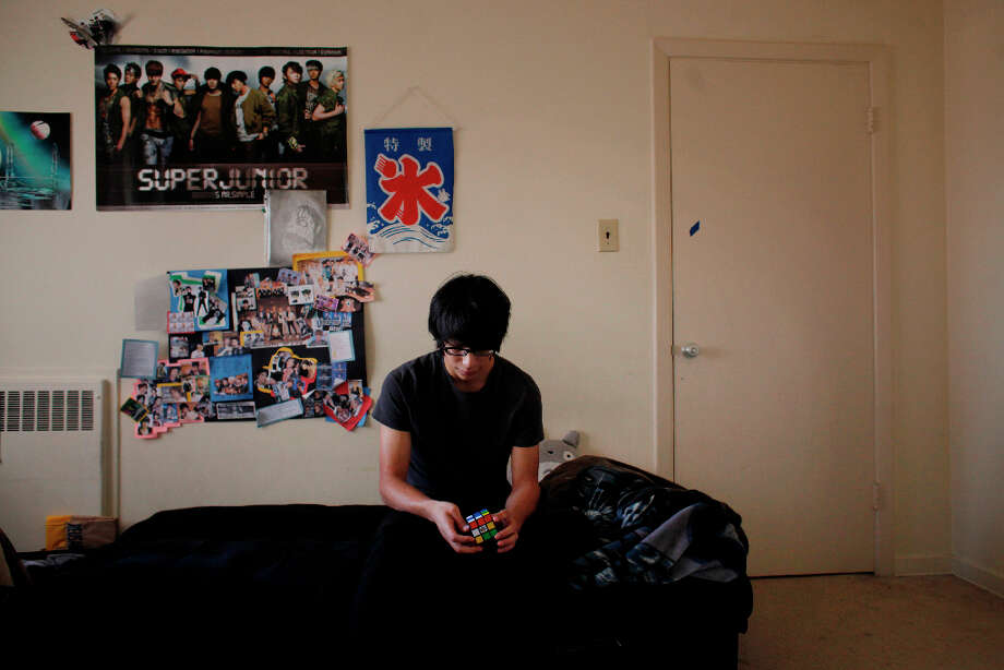 Francisco Perez, 18, fiddles with a Rubik's Cube in his apartment near San Francisco State University. Photo: Mike Kepka, The Chronicle / ONLINE_YES