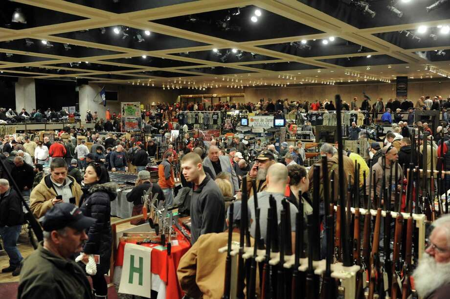 Firearm enthusiast peruse the selection at dealers at the New York State Arms Collectors Show at the Empire State Plaza on Saturday Jan. 26,2013 in Albany, N.Y. (Michael P. Farrell/Times Union) Photo: Michael P. Farrell