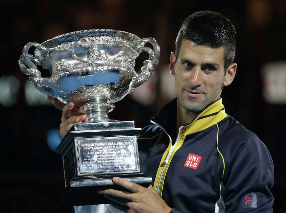Serbia's Novak Djokovic holds his trophy after defeating Britain's Andy Murray in the men's final at the Australian Open tennis championship in Melbourne, Australia, Sunday, Jan. 27, 2013. (AP Photo/Dita Alangkara) Photo: Dita Alangkara, STF / AP