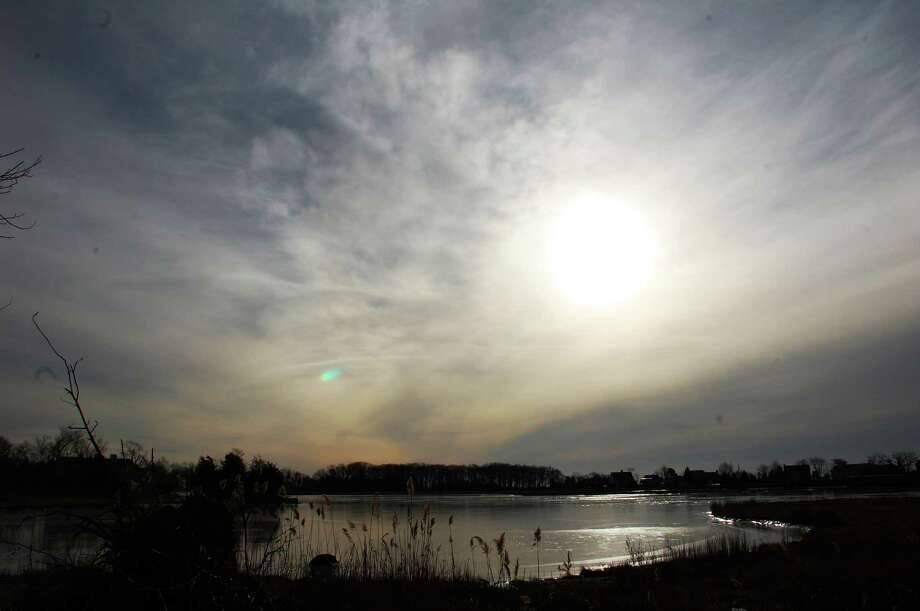 Sunrise over Sherwood Mill Pond, which the committee charged with its stewardships says is being choked by sand buildup.  WESTPORT NEWS, CT 1/25/13 Photo: Jarret Liotta / Westport News contributed