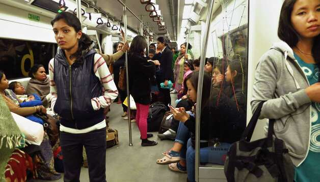 Indian women travel in a women-only metro train compartment in New Delhi, India, on Friday. The attack and brutal rape of a 23-year-old student in the heart of New Delhi last month has brought protesters into the streets demanding the government protect women and ensure those attacked get justice. Women say they feel under siege and are so frightened they have structured their entire lives to protect themselves from harassment and attack. Many travel in groups, go out of their homes only during the day and carry sharp objects to stab men who grope them on public buses. Photo: AP