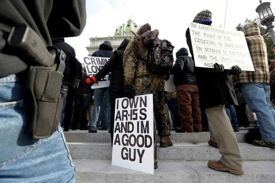 Gun rights advocates demonstrate at the Pennsylvania Capital building Wednesday in Harrisburg, Pa. The rally comes amid calls for a boycott of the nine-day Eastern Sports and Outdoor Show in Harrisburg next month, and a growing list of vendors pulling out of the show. Photo: AP