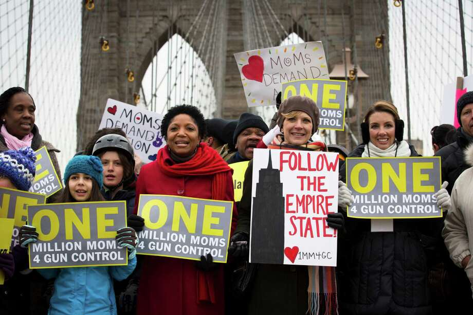 Demonstrators march over the Brooklyn bridge towards downtown Manhattan during the One Million Moms for Gun Control Rally on Monday in New York. Demonstrators called for new gun control legislation, demanding a ban on assault weapons and stricter regulations on gun purchases. Photo: AP