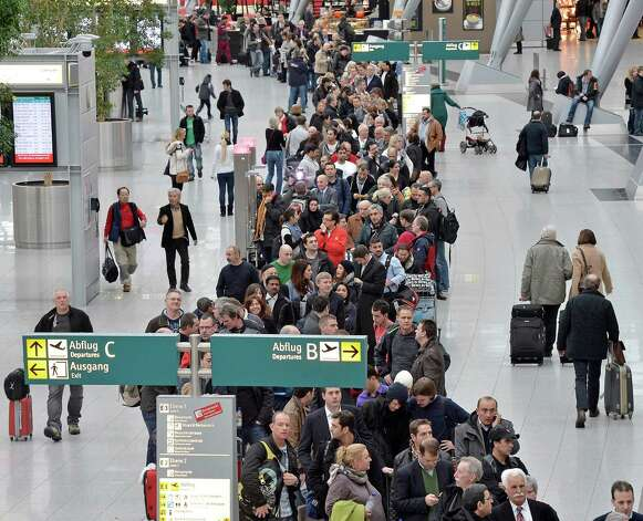 Passengers are waiting in long queues for security checks at the international airport in Duesseldorf, Germany, Friday. Due to a strike by the security personnel for the second day at several German airports flights had to be cancelled or were delayed. Photo: AP