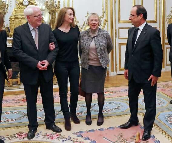 Frenchwoman Florence Cassez, center, is seen with her parents Bernard and Charlotte during a meeting with French President Francois Hollande at the Elysee Palace in Paris, Friday. Florence Cassez, who spent seven years in prison in Mexico on kidnapping charges returned to a hero's welcome in Paris on Thursday, declaring she had been cleared by the Mexican court that ordered her freed. Photo: AP