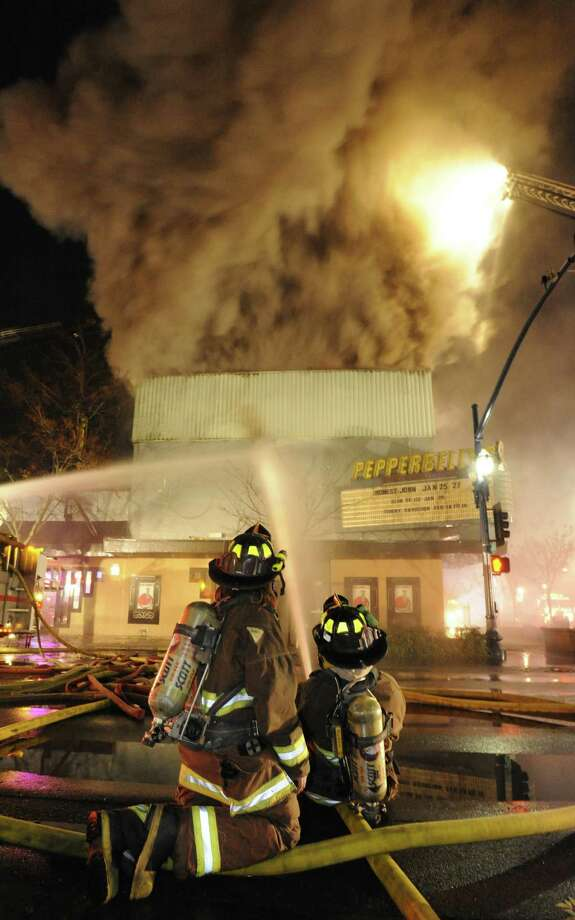 Smoke billows into the air above Pepperbelly's Comedy Club in Fairfield, California as firefighters continue their attack on the five-alarm blaze on Friday in Fairfield, Calif. Photo: AP