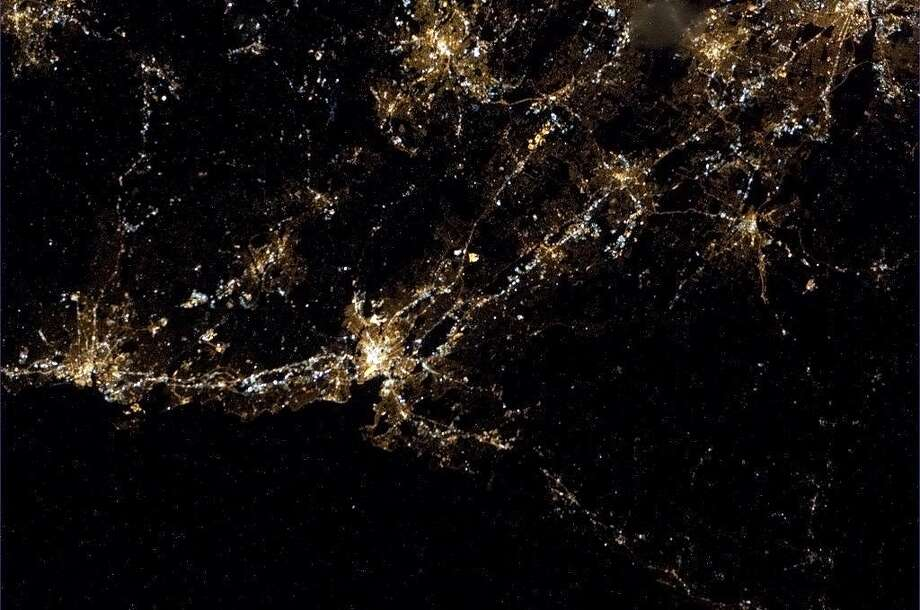Hadfield tweeted about this photo: New England coast at night, from New Haven up to Hartford CT.Can you name the other cities? Well-lit Interstates 95 and 91 help provide some context.