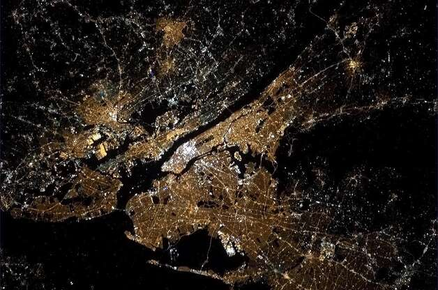 Hadfield tweeted about this photo: New York City shining by night. Central Park is visible from space, and maybe even the light on the Statue of Liberty.Also, Times Square. Yikes.
