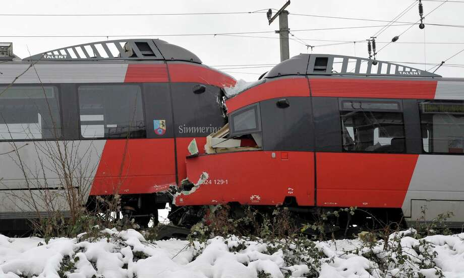 The driver's cabins are seen destroyed after two regional trains crashed head on in Vienna, Austria, Monday. Several  people were injured. Photo: AP