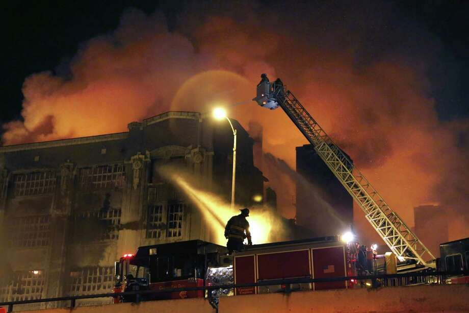 Chicago firefighters battle a five-alarm blaze in single digit temperatures at a warehouse on the city's South Side, Bridgeport neighborhood Wednesday in Chicago. Photo: AP