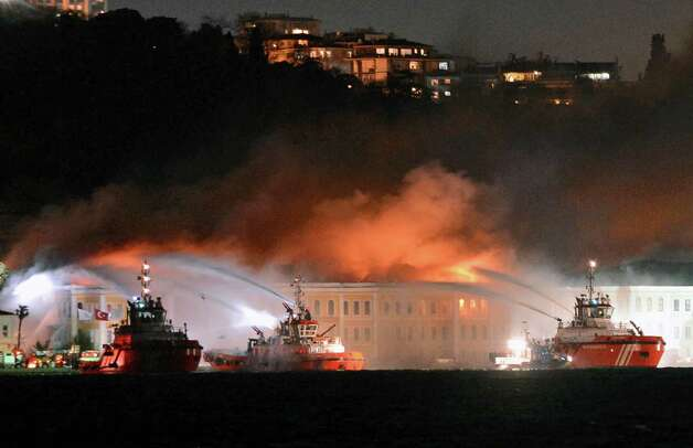 Firefighters work to extinguish a blaze raging through a historic former mansion that is now part of Galatasaray University campus on the Bosporus in Istanbul, Turkey, Tuesday. No one is believed to be trapped inside the wooden building used by the prestigious Galatasaray University, and there were no reports of any injuries, reports say. Photo: AP