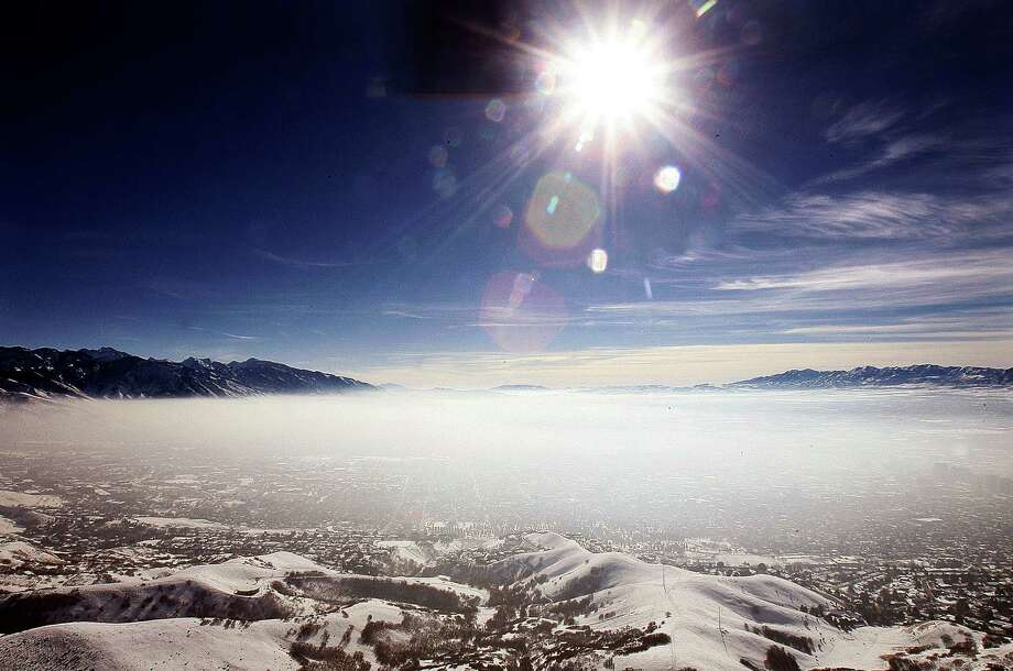 An inversion cloud covers downtown Salt Lake City on Jan. 9.  A group of Utah doctors is declaring a health emergency over the Salt Lake City area's lingering air pollution problem. Utah Physicians for a Healthy Environment planned to deliver a petition Wednesday demanding immediate action by elected officials. Photo: AP