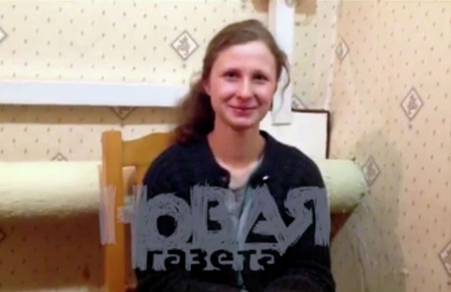"In this video grab made in December, 2012, and provided by APTN Maria Alekhina, an imprisoned member of the Pussy Riot feminist punk band, is seen in prison uniform at a prison colony in the town of Berezniki, somef 940 miles north-east of Moscow,  in the Ural Mountains, where she talked to the Russian independent newspaper Novaya Gazeta while serving her two-year sentence. The imprisoned members of the Pussy Riot feminist punk band say they feel no regrets about the irreverent ""punk prayer"" against President Vladimir Putin in Moscow's main cathedral that landed them behind bars for two years. Nadezhda Tolokonnikova and Maria Alekhina offered a vivid, but stoic, description of their harsh prison conditions in interviews published Wednesday in the independent Novaya Gazeta newspaper. They said they don't expect clemency from authorities.  Photo: AP"