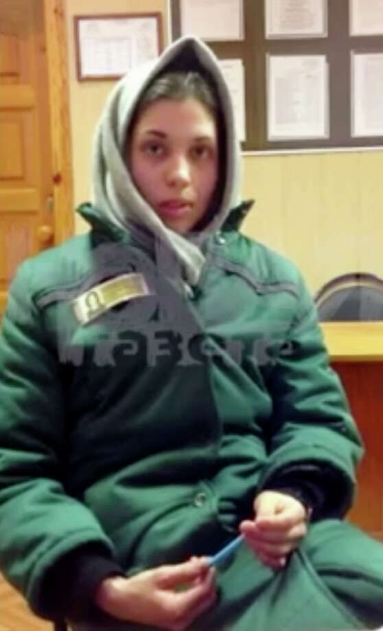 In this video grab made in December, 2012, and provided by APTN, Nadezhda Tolokonnikova, an imprisoned member of the Pussy Riot feminist punk band, is seen in prison uniform at a prison colony in the province of Mordovia in western Russia, where she talked to the Russian independent newspaper Novaya Gazeta. Photo: AP