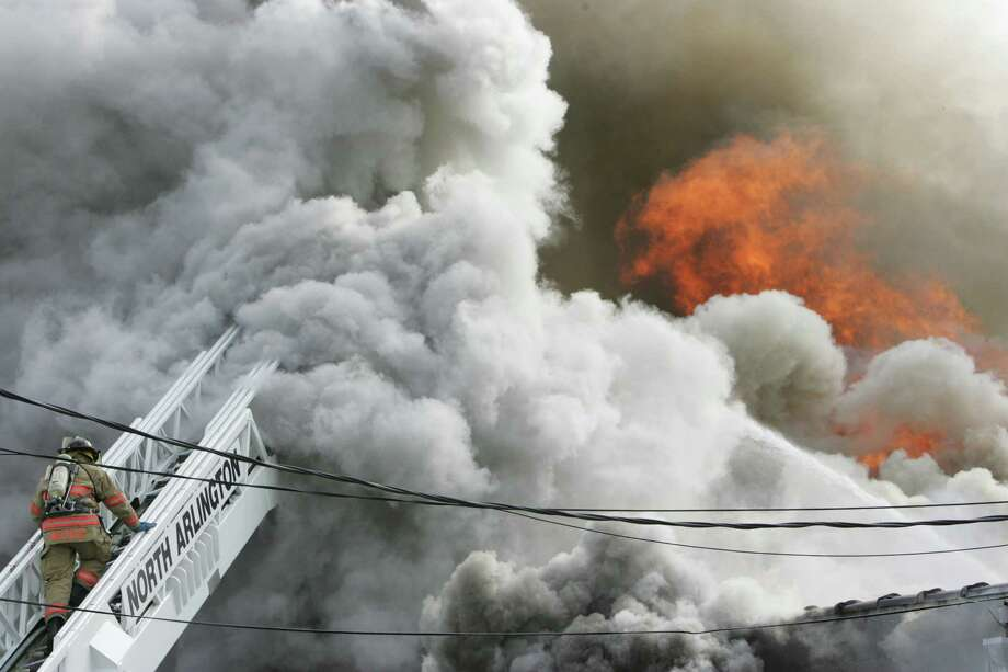 A huge fire engulfed a metal fabrication warehouse on Wednesday. Fire Departments from numerous surrounding towns assisted to battle the multiple alarm fire. Photo: AP