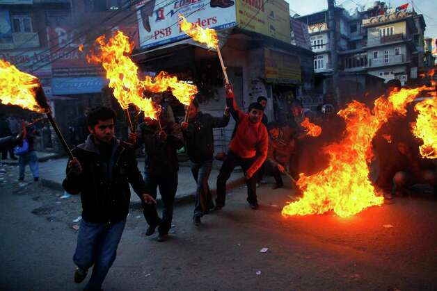 Activists of Nepali Congress party affiliated Nepal Student Union light torches as they begin a torch rally through the streets against Prime Minister Baburam Bhattarai in Katmandu, Nepal, Sunday. Bhattarai has been running a caretaker government since May last year, but the opposition parties want him to step down. Photo: AP