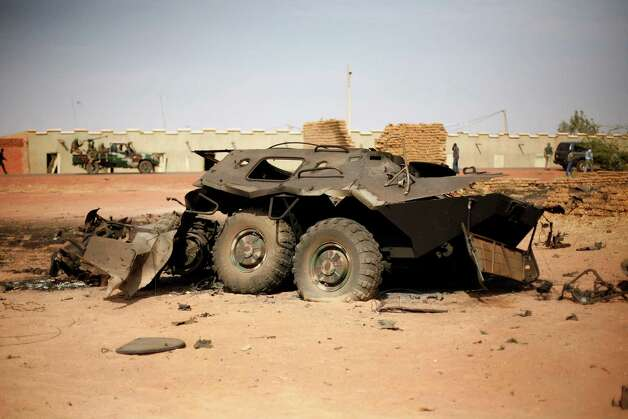 In this image taken during an official visit organized by the Malian army to the town of Konna, some 430 miles north of Mali's capital Bamako on Saturday a Malian army armored vehicle used by islamist rebels stands charred. One wing of Mali's Ansar Dine rebel group has split off to create its own movement, saying that they want to negotiate a solution to the crisis in Mali, in a declaration that indicates at least some of the members of the al-Qaida linked group are searching for a way out of the extremist movement in the wake of French air strikes. Photo: AP
