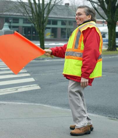 "Judge of Probate Marty Landgrebe lends a valuable hand by directing traffic during the ""Cold Homes, Warm Hearts"" 5K Walk, hosted Jan. 13, 2013 by New Milford Social Services to benefit the community fuel bank. Photo: Trish Haldin"