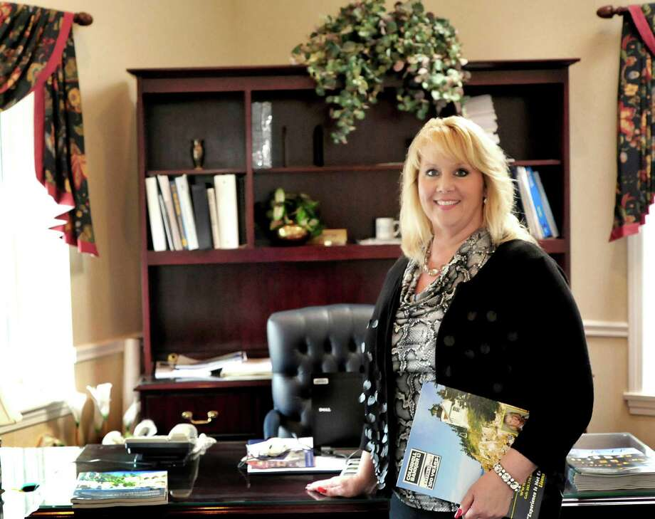 """Realtor Kim Gifford stands in her office at Coldwell Banker in Danbury Thursday, Jan. 31, 2012. She will appear on TLC's """"My First Home."""" Photo: Michael Duffy"""