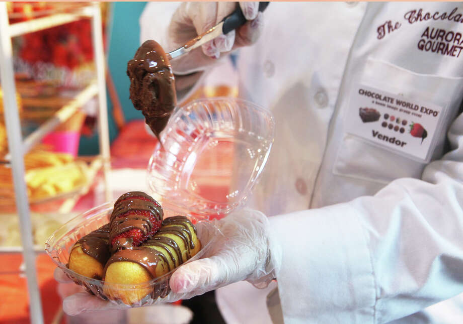 Twinkies and a strawberry are covered in chocolate, from Aurora Gourmet,  at the Chocolate World Expo at the Maritime Aquarium in Norwalk, Conn. on Sunday, January 27, 2013. Photo: BK Angeletti, B.K. Angeletti / Connecticut Post freelance B.K. Angeletti